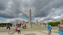 People visit  Vigeland's obelisk in public Frogner park Stock Footage