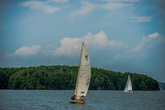 sail boat on large lake - stock photo