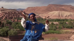 Berber and snake of Drâa in Morocco Stock Footage