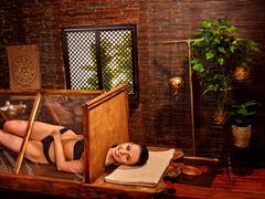 Woman having Ayurveda sauna - stock photo