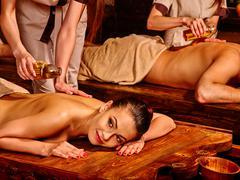 Couple having Ayurvedic spa treatment Stock Photos