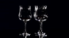 Glasses on black background. The camera motion in a circle - stock footage