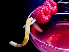 raspberries drink on black background - stock photo