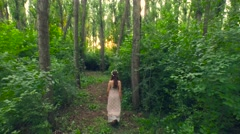 Beautiful Young Fairy Tale Princess Walking Down Enchanted Forest At Sunset Stock Footage