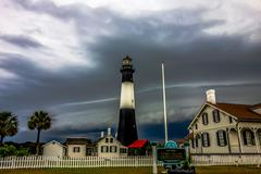 Stock Photo of tybee island beach lighthouse with thunder and lightning