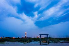 Tybee island beach lighthouse with thunder and lightning Kuvituskuvat