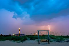 Tybee island beach lighthouse with thunder and lightning Stock Photos