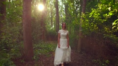 Beautiful Young Fairy Tale Bride Woman Princess Walking Down Forest Path Sun - stock footage