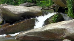 water falls flowing through mountain river - stock footage