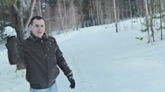 Couple having snowball fight in snow in winter forest Arkistovideo