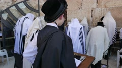 Men Swaying During Prayer at Western Wall in 4K Stock Footage