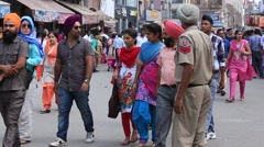 Indian people in a street near Golden Temple, Amritsar. India Stock Footage