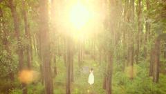 Beautiful Young Woman Vintage White Bride Dress Walking Through Mystery Forest Stock Footage