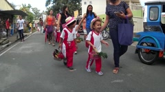 Children parade on street with guardians Stock Footage