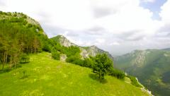 Aerial Shot Of Beautiful Cliffs Mountains Rocky Landscape Green Grass Trees Stock Footage