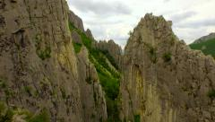 Epic Fly Through Between Mountain Cliffs Rocks Close Aerial Mountain Range Stock Footage