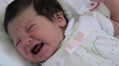 Newborn baby girl crying Stock Footage