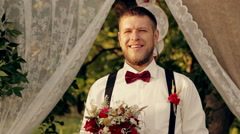 The groom is waiting for the bride HD video Stock Footage