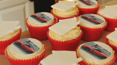 Placing newly baked cup cake in box 4K - stock footage
