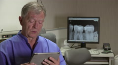 Dentist says tablet radiography Stock Footage