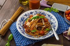 Wholemeal pasta with roasted tomato - stock photo