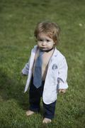Stylish baby boy in unbuttoned shirt Stock Photos