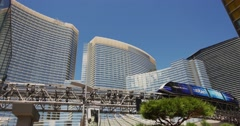 Steadicam Las Vegas Hotel Aria with a passing monorail Stock Footage