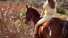 Pretty woman riding on a horse Stock Footage