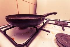 Dirty grubby gas stove in kitchen - stock photo