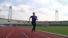 Sprinters training at tracks Stock Footage