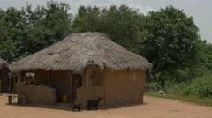 Ghana African mud houses pan 4K Stock Footage