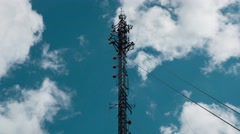 4k - Communication antenna timelapse with clouds Stock Footage