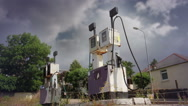 Stock Video Footage of Storm Clouds over Discarded Petrol Pumps