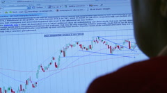 Person looks at stock market on PC Stock Footage