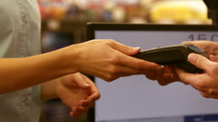 Woman paying for her purchases with credit card Stock Footage