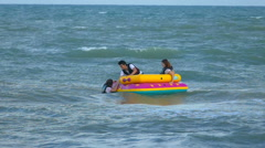 Footage of tourists teen on a banana boat or sofa boat having fun and relax Stock Footage