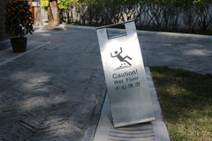Sign showing warning of caution wet floor Kuvituskuvat