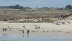 Beach with people in Brittany, France. Stock Footage