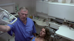 Dentist sets up its projector - stock footage