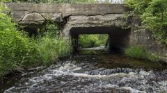 Northern Maine: River through Culvert, Wide Stock Footage