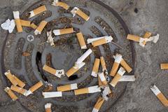 Cigarette butts littering - stock photo