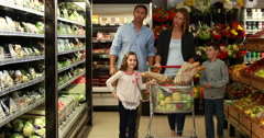 Happy family grocery shopping together Arkistovideo