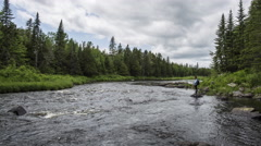 Northern Maine: River through Woods with Fishers Stock Footage