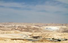 The Dead Sea Works is an Israeli potash plant in desert . Stock Photos