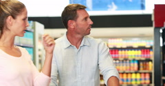 Couple shopping in grocery store Stock Footage