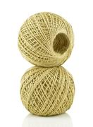 Roll of twine cord isolated on white background - stock photo