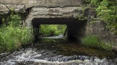 Northern Maine: River through Culvert, Medium Shot Stock Footage