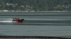 Red speed boat passing by Stock Footage