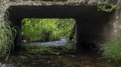 Northern Maine: River through Culvert, Med Stock Footage
