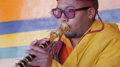 Musician plays horn at the masked dance Festival,Lamayuru,Ladakh,India Stock Footage
